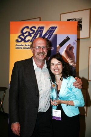 Dawn posing with her graduate supervisor, Dr. Bob Hancock, after winning the Cangene Gold Award for the best PhD thesis in Microbiology for 2005.