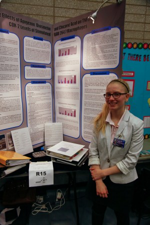 Catherine Bowman beside her award winning poster (BASEF, March 2014).