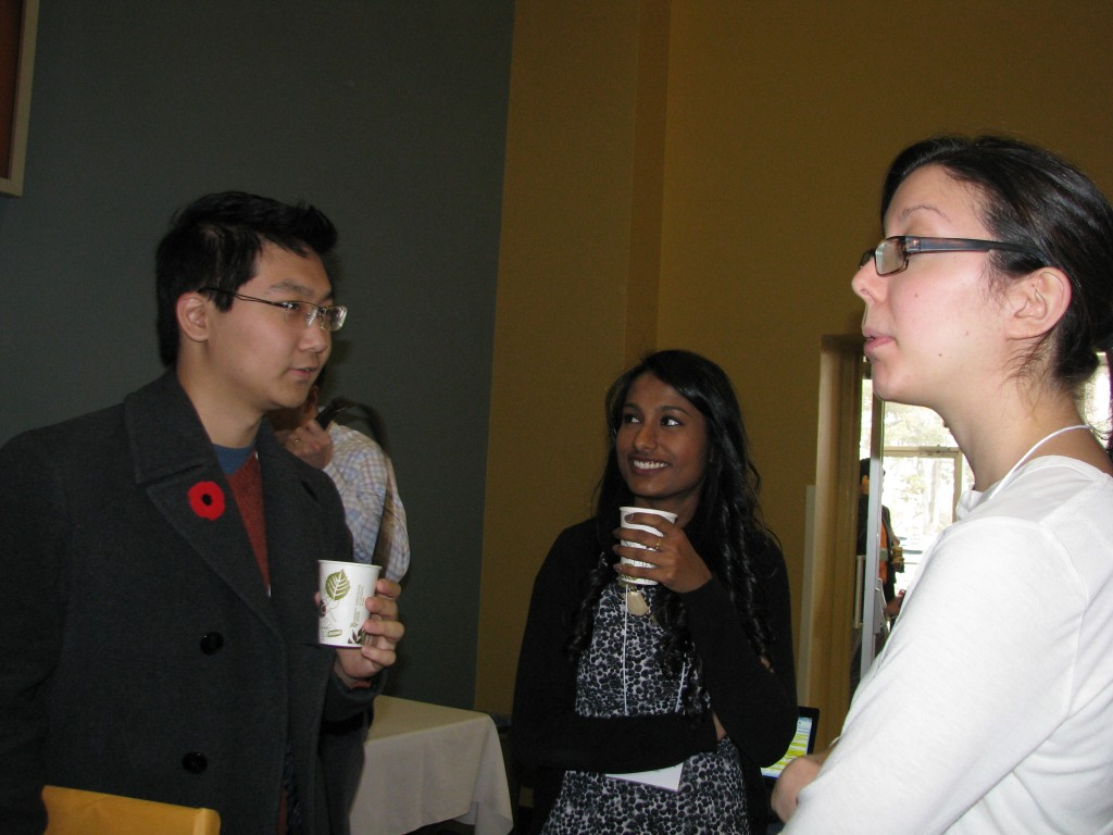 Bowdish lab members past (Charles Yin and Julie Kaiser) and present (Netusha Thevaranjan) catche up at IIRF 2014.