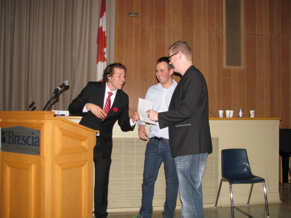 Kyle Novakowski (PhD candidate) receives his award for the best poster award as chosen by the audience.
